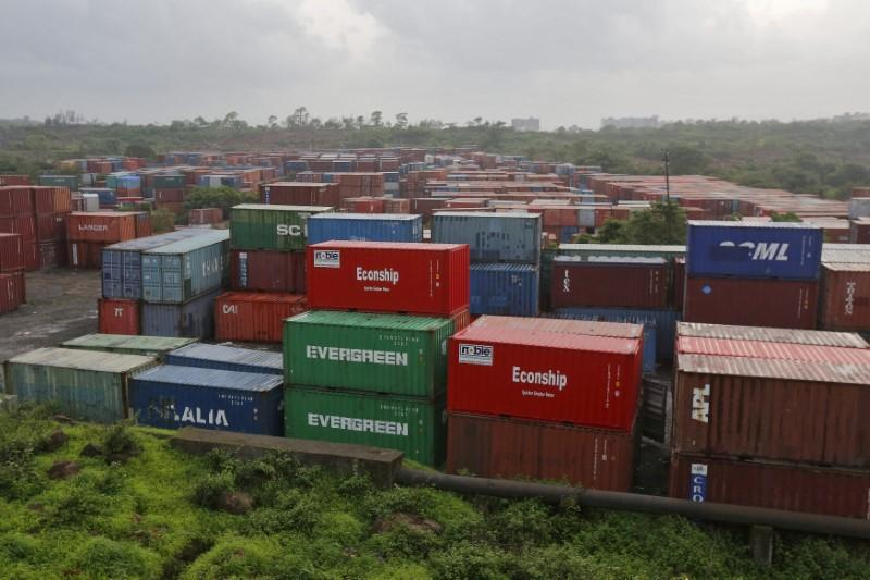 Cargo containers are seen stacked outside the container terminal of Jawaharlal Nehru Port Trust (JNPT) in Mumbai, India, July 15, 2015. Shailesh Andrade