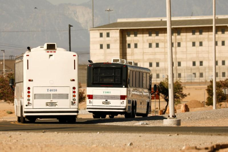 Immigration and Customs Enforcement (ICE) detainees arrive at FCI Victorville federal prison in Victorville, California, U.S. June 8, 2018. Patrick T. Fallon