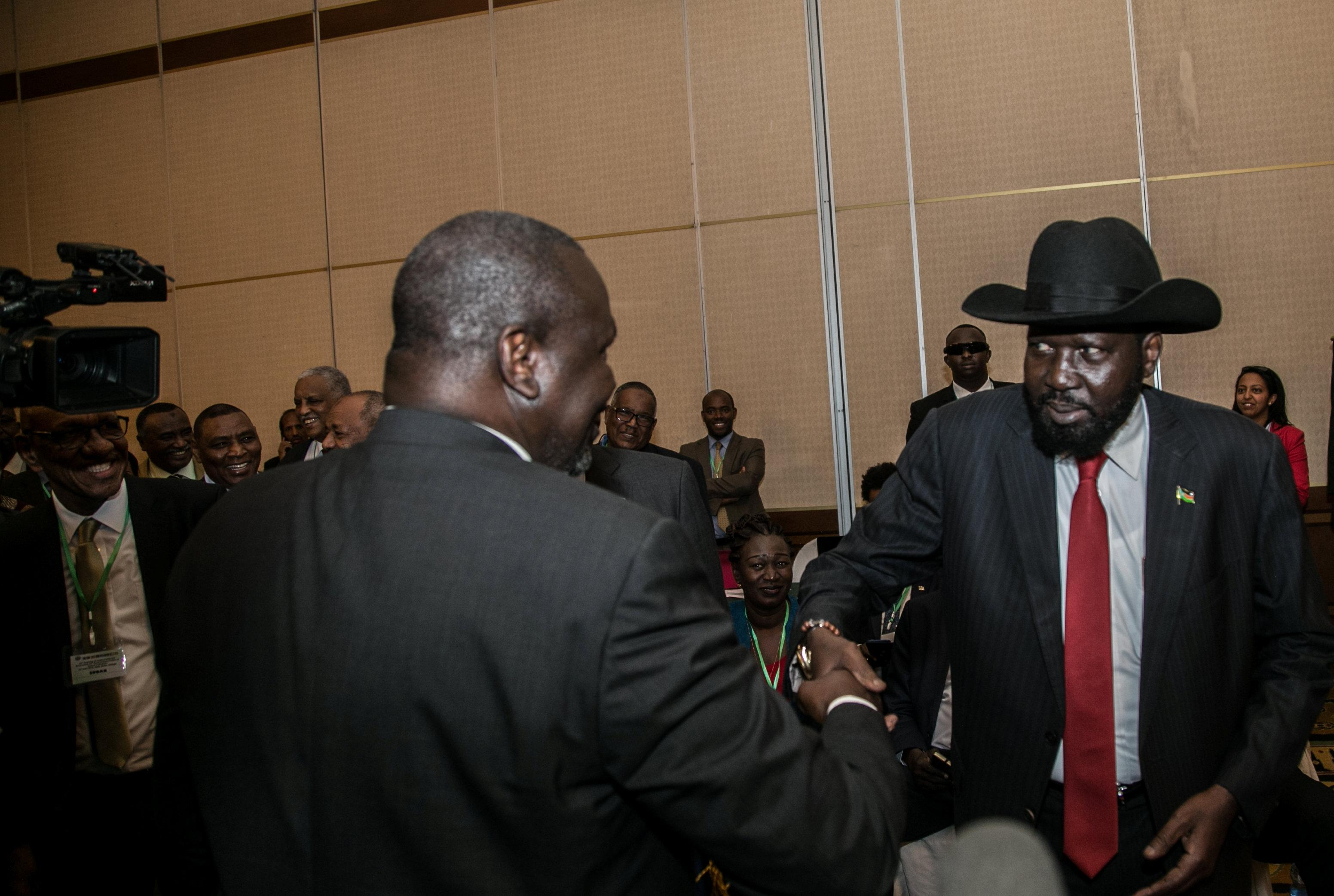 South Sudan President Salva Kiir (R) greets South Sudan Rebel leader Riek Machar during the 32nd Extra-Ordinary Summit of IGAD Assembly of Heads of State and Government in Addis Ababa, Ethiopia June 21, 2018. Presidential Press Service/Handout via