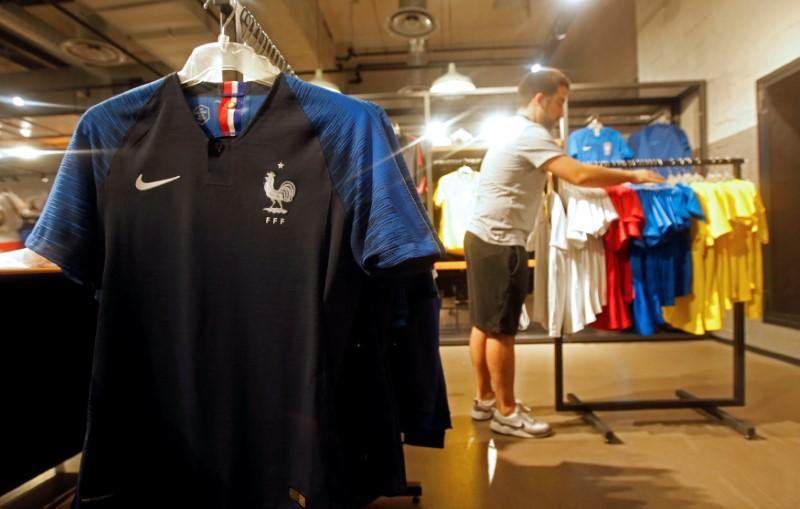 super popular f0c85 3f8c7 France team soccer jerseys are displayed in a Nike sporting goods store in  Marseille, France