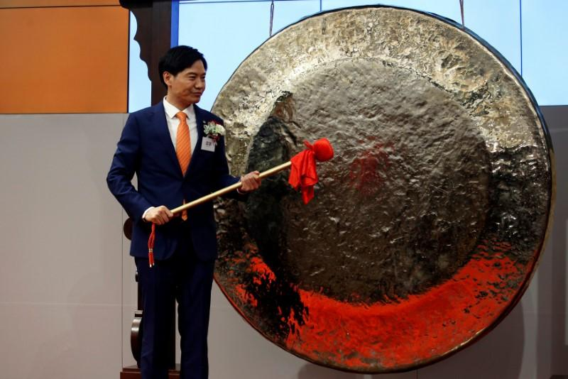 Xiaomi founder, Chairman and CEO Lei Jun prepares to hit the gong during the listing of the company at the Hong Kong Exchanges in Hong Kong, China July 9, 2018.   Bobby Yip