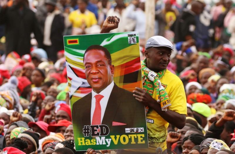 Supporters wait for President Emmerson Mnangagwa to address an election rally of his ruling ZANU (PF) party in Bindura, Zimbabwe July 7, 2018. Philimon Bulawayo
