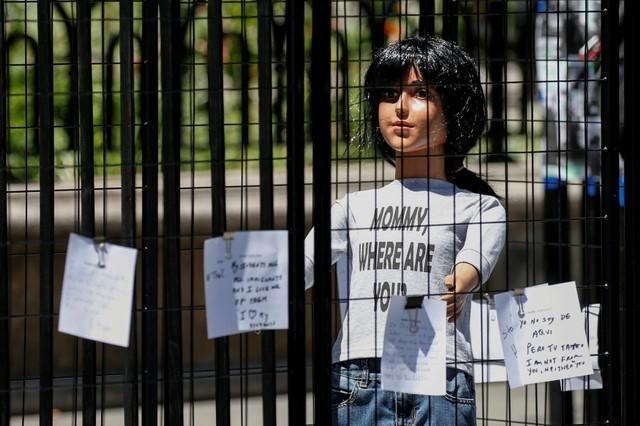 A sculpture by artist Marilyn Miller depicts a life-size immigrant child separated by cages from the mother in New York City, U.S., July 19, 2018. Brendan McDermid