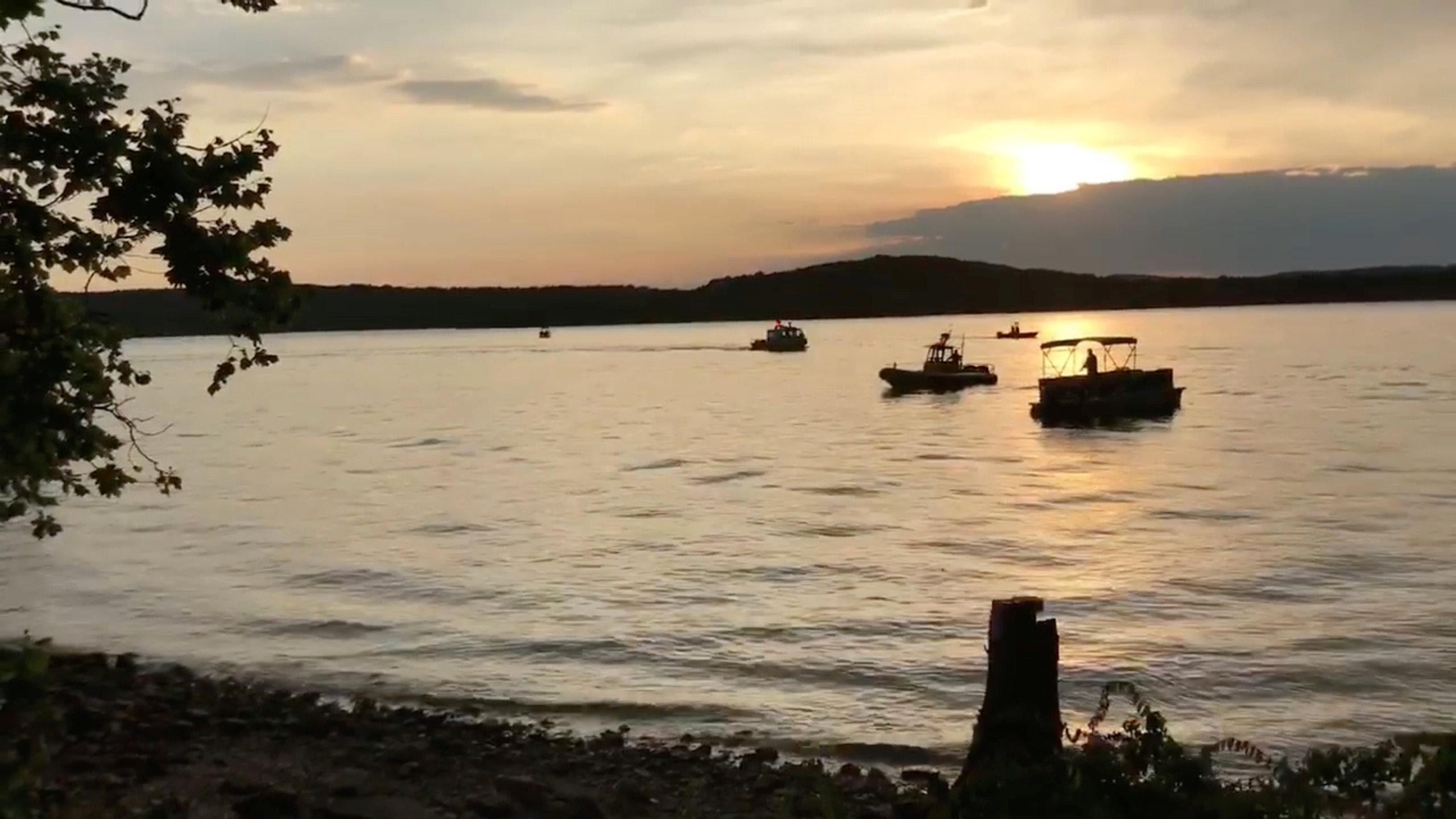 "Rescue personnel work after an amphibious ""duck boat"" capsized and sank, at Table Rock Lake near Branson, Stone County, Missouri, U.S. July 19, 2018 in this still image obtained from a video on social media.  SOUTHERN STONE COUNTY FIRE PROTECTION DISTRICT/Facebook/via"