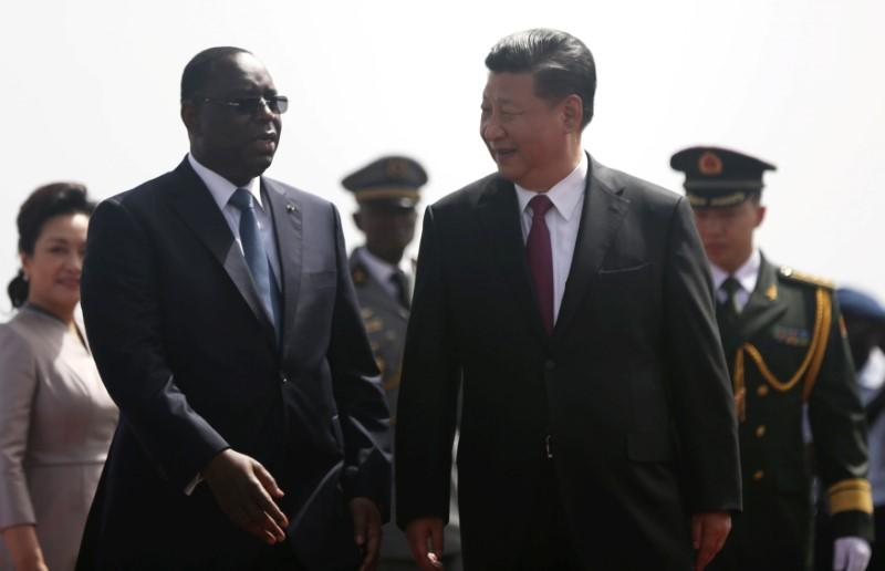 Chinese President Xi Jinping walks with Senegal