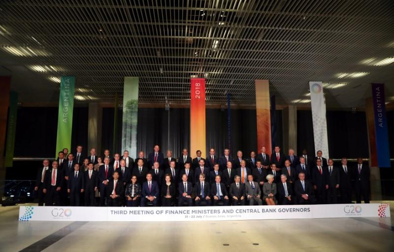 Finance ministers and Central Bank presidents pose for the official photo at the G20 Meeting of Finance Ministers in Buenos Aires, Argentina, July 21, 2018. Marcos Brindicci