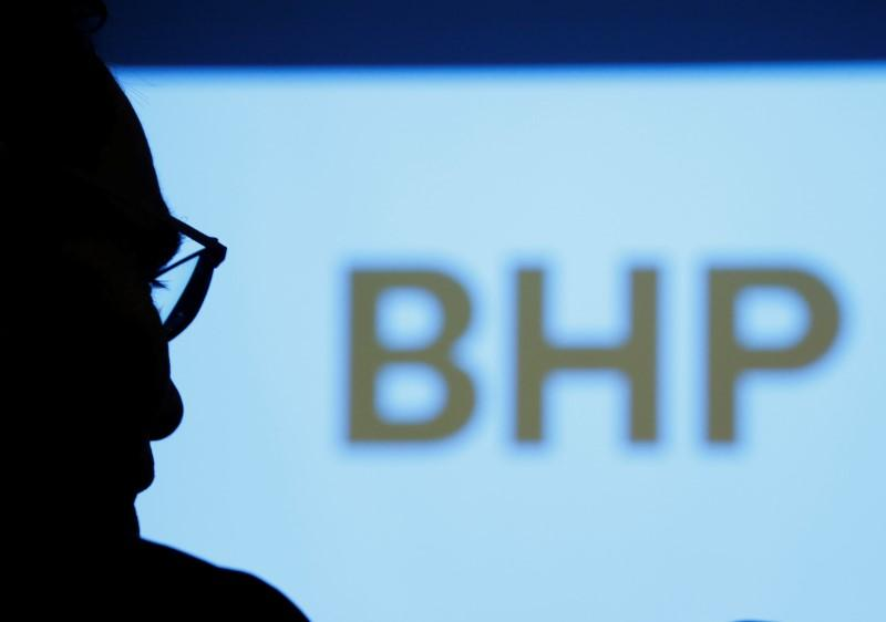 BHP Billiton Chief Executive Andrew Mackenzie is silhouetted against a screen projecting the company's logo at a round table meeting with journalists in Tokyo, Japan June 5, 2017. Kim Kyung-Hoon
