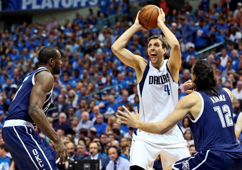 Apr 23, 2016; Dallas, TX, USA; Dallas Mavericks forward Dirk Nowitzki (41) looks to pass as Oklahoma City Thunder center Steven Adams (12) defends during the second quarter in game four of the first round of the NBA Playoffs at American Airlines Center. Mandatory Credit: Kevin Jairaj-USA TODAY Sports/Reuters Picture Supplied by Action Images