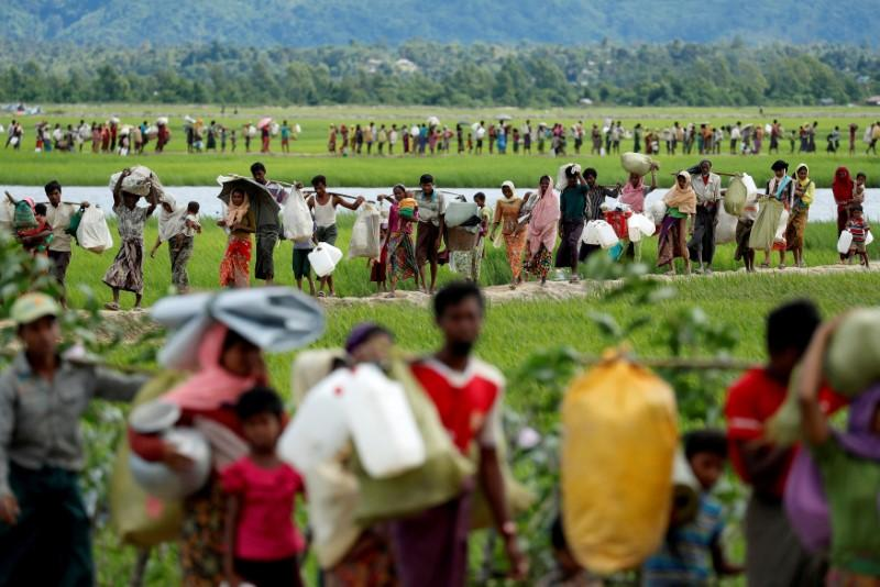 Rohingya refugees, who crossed the border from Myanmar two days before, walk after they received permission from the Bangladeshi army to continue on to the refugee camps, in Palang Khali, near Cox's Bazar, Bangladesh October 19, 2017. Jorge Silva