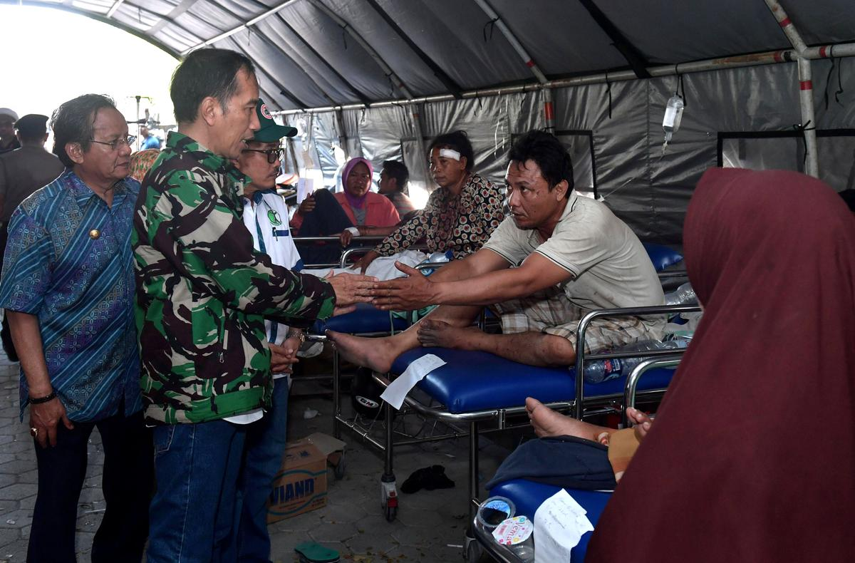Indonesia rushes to help quake-hit island, death toll likely to soar past 830
