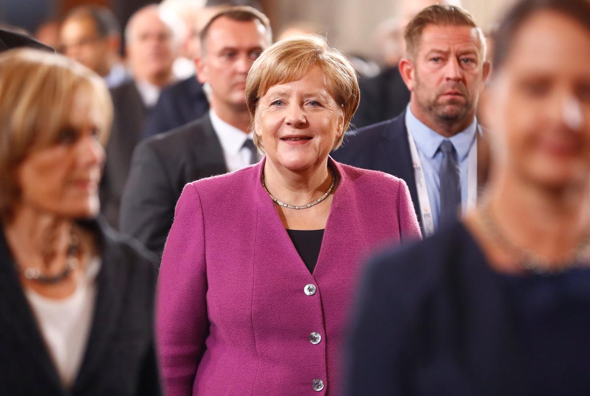 German conservatives back Merkel bid for party leadership