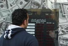 A man stands outside an exchange bureau in Cairo December 30, 2012. REUTERS/Asmaa Waguih