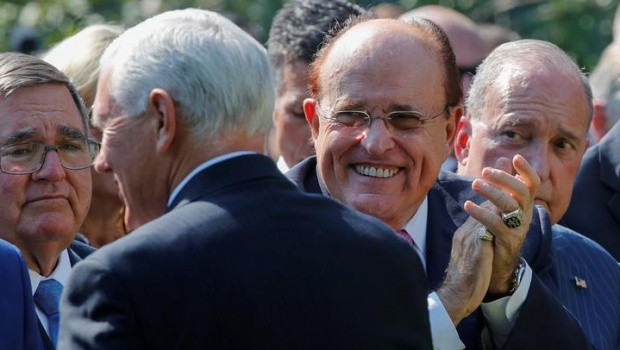 "Rudy Giuliani, lawyer for U.S. President Donald Trump and former mayor of New York City, applauds Vice President Mike Pence with White House chief economic advisor Larry Kudlow at a signing ceremony for the ""Permanent Authorization of the September 11th Victim Compensation Fund Act"" in the Rose Garden of the White House in Washington, U.S., July 29, 2019. REUTERS/Carlos Barria"