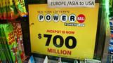 Americans wish for luck in $700M Powerball jackpot