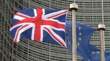 May hits Brussels in bid to break Brexit deadlock