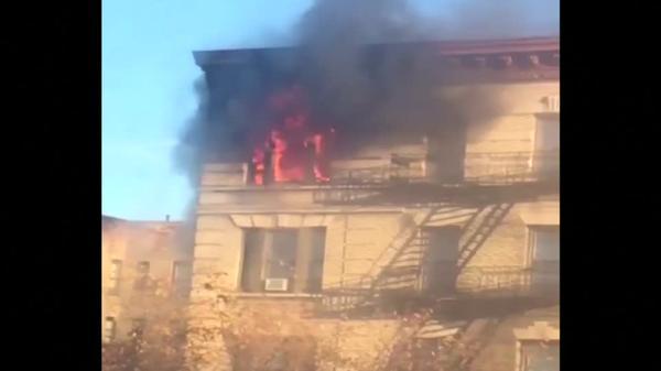Fire engulfs top floor of Manhattan apartment building