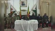Zimbabwe's Mugabe defies demands he quit