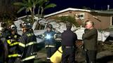 Small plane crashes into California home injuring three