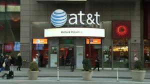 AT&T sued, tech lifts Wall Street