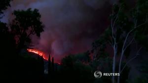 Fierce winds power California's third-largest wildfire