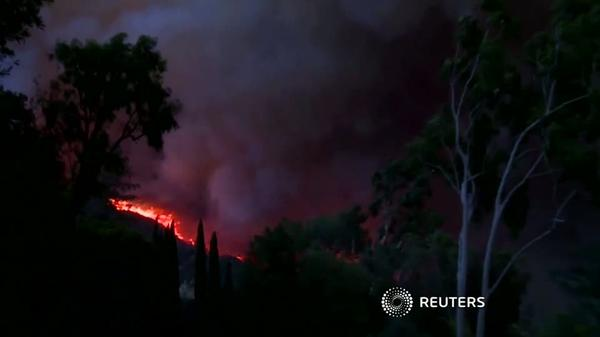 Fierce winds power California's third-largest wildfire