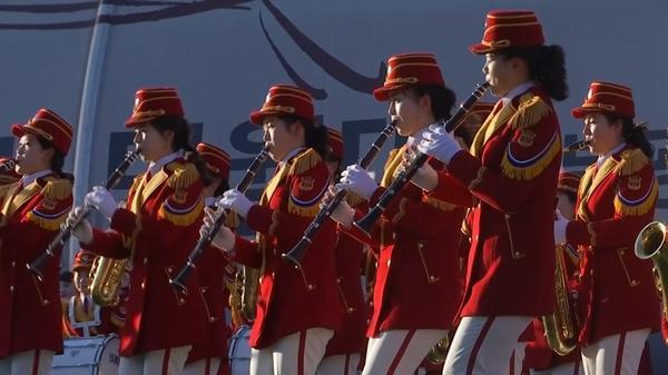 North Korean cheerleaders perform on the sidelines of Winter Olympics