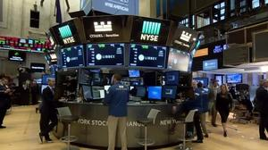 Wall St falls on yields spike