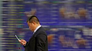 Asian markets slide on Facebook and Fed concerns