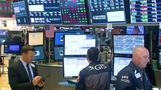 Wall Street dips on trade, oil price concerns