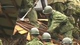 Rescuers dig for survivors in flooded Japan
