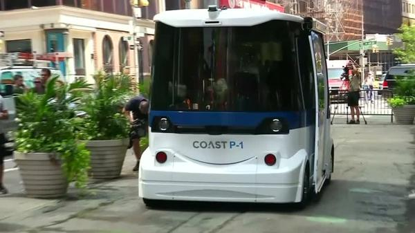 A driverless shuttle in Times Square