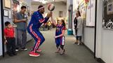 Harlem Globetrotter visits double amputee girl who lost prosthetics in California wildfires