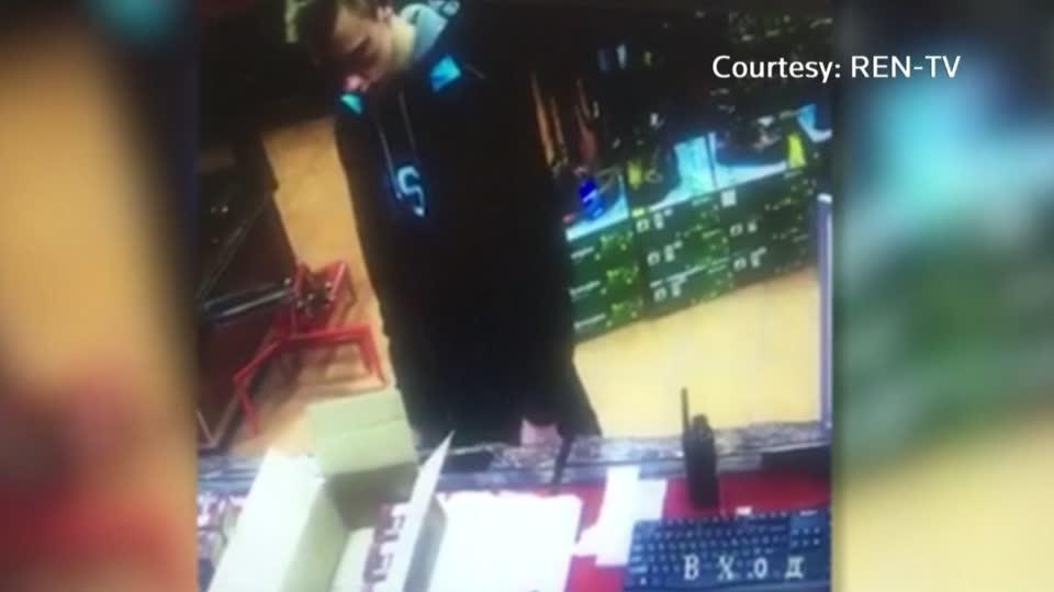 Crimean gunman seen buying shotgun shells on CCTV