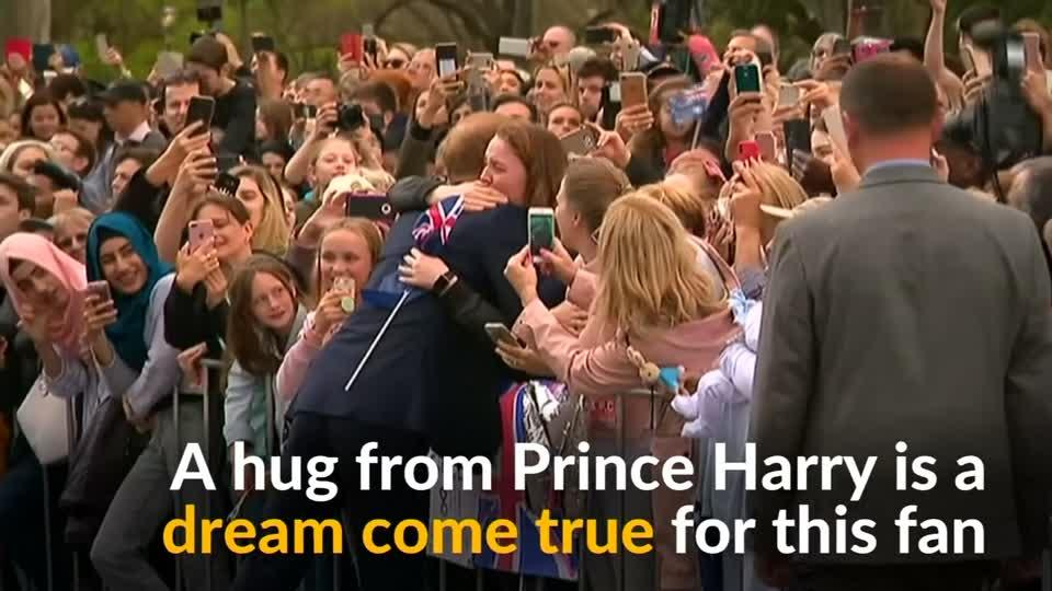 Hug from Harry makes royal fan cry with joy