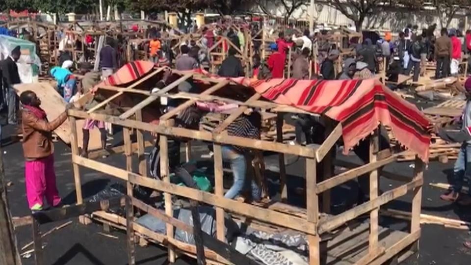 African migrants rebuild Casablanca camp after fire