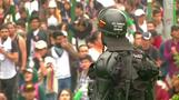Riot police fire tear gas at protesting students in Colombia