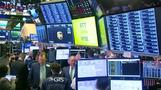 Wall Street ends choppy day higher