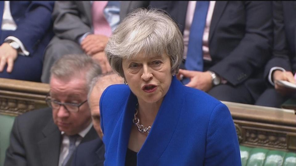 May's government wins confidence vote