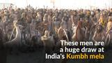 Ash-smeared holy men attract crowds at India's Kumbh Mela