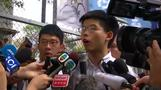 Hong Kong's Joshua Wong walks free, vows to join protest