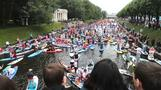 Paddleboard masquerade brings colors to St. Petersburg canals