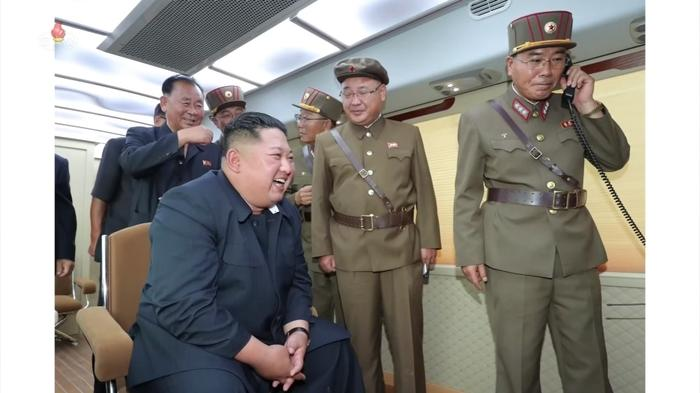 North Korea's state TV airs photos of Kim Jong Un watching new weapon test