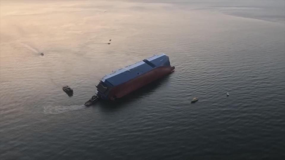 4 remain missing after cargo ship capsizes