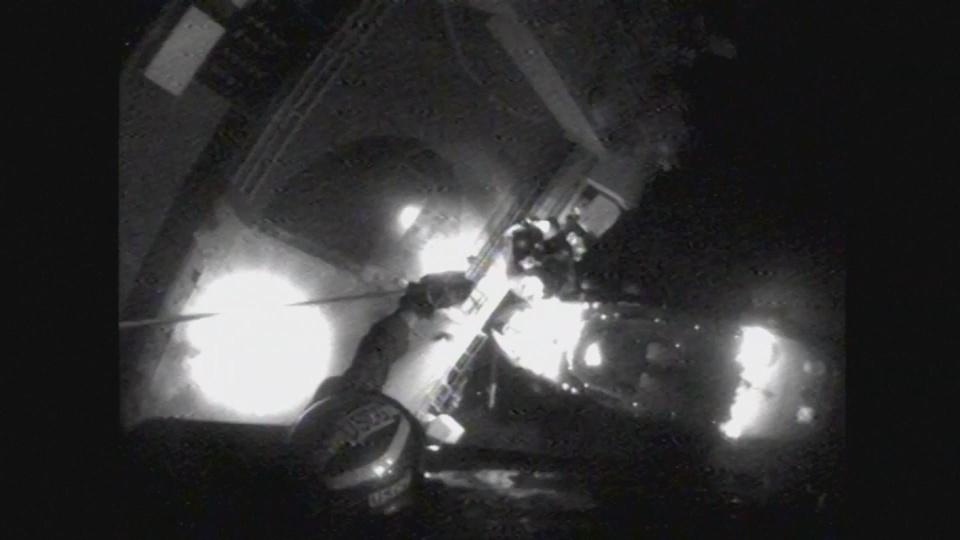 US Coast Guard hosts crew to safety