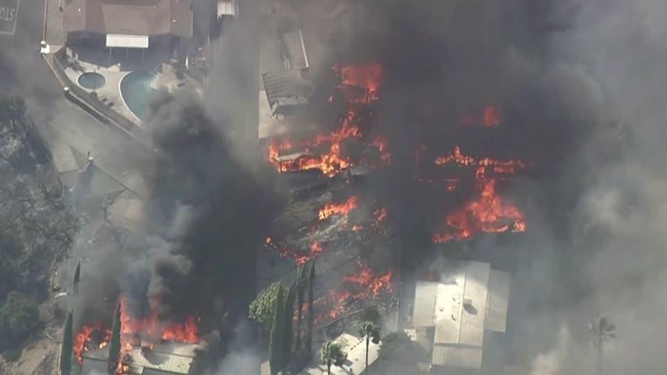 Fire roars through California neighborhood