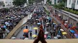 Hong Kongers rally under stormy skies