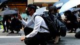 Rare weekday protests flare in Hong Kong