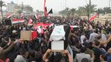 Death toll rises in Iraq bloodshed, mourners bury dead