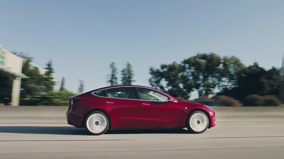 Tesla tops $100 billion in market valuation