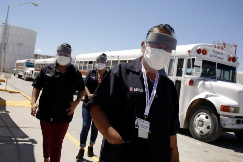 Nervous workers return to virus-hit plant in Mexico